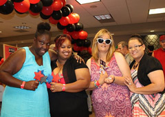 Tamika Green, Reba Jordan, Tracy Wagner, and Valerie Gutierrez pose with their winnings from Monte Carlo Night at IRC.