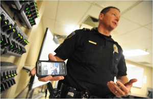 Rialto Police Department Sgt. Chris Hice exhibits an inventory of body cameras at police headquarters.