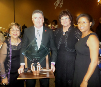 Black Culture Foundation's Humanitarian of the Year honoree Tim Evans, with newspaper publishers: Gloria Harrison, Margie Miller, and me.