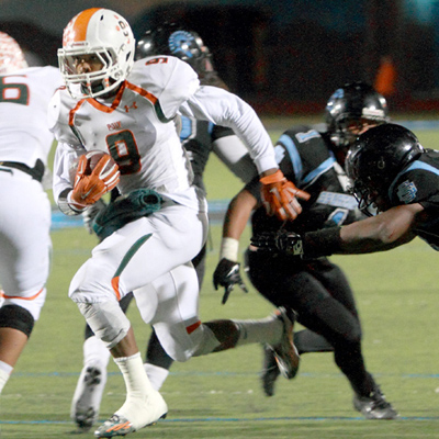 Riverside Poly's Devontre Hale streaks through the Spartans' defense last Friday during their second round CIF playoff matchup. Poly won the right to advance by beating San Gorgonio 38-33 and will play Heritage in the semi-finals on Friday. Photo by: Robert Attical