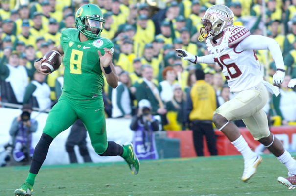 Making Things Happen – Oregon's junior quarterback Marcus Mariota scampers away from Seminole defenders during Thursday's Playoff Semi-final Rose Bowl game. Mariota, the 2014 Heisman winner was also awarded the game's offensive MVP. Photo by Robert Attical
