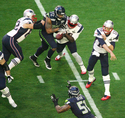 Brady completes one of his record number completions against Seattle