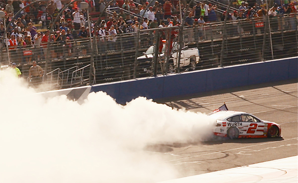 FONTANA AUTO CLUB 400 - Winner Brad Keselowski smokes the tires as celebrates his victory on the last lap, in front of a sell out crowd on Sunday.