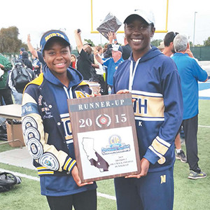 Jumps Team Members – Bria Palmer (L) and Emem Ibekewe hold the CIF-SS Runner Up plaque. Both will compete in Friday's Master Meet for an opportunity to advance to the state competition. Photo by: Robert Attical