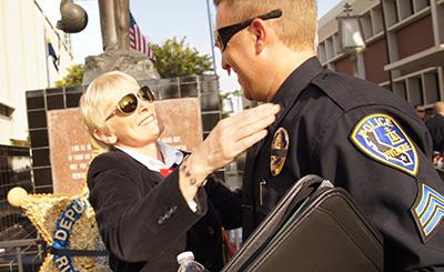 Carole Nagengast hugs Sgt. Charlie Payne