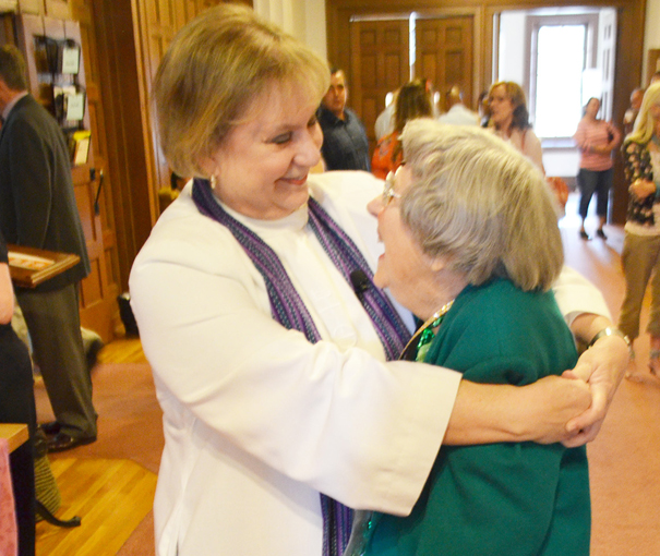 Bette Brown and Rev. Quandt share a hug.