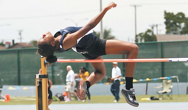 Up and Away – North senior Bria Palmer soars over the bar at 5-05.00 to grab the last qualifying spot advancing to the CIF-SS Master's Meet on Friday. Photo by Jon Gaede