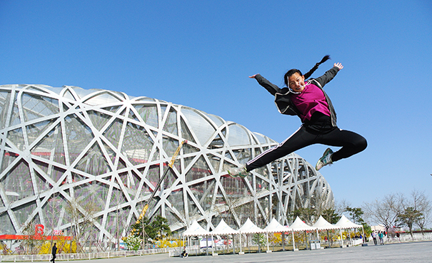 North High student Serena Lowe in front of the Beijing China National Stadium