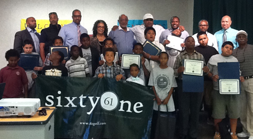 Charlie Seymour's family celebrates with academy class, school principals, and the academy director.