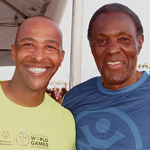 Photo by Jon D. Gaede (L) Dain Blanton, first African American to win an Olympic Gold Medal in Beach Volleyball (Sydney 2000) with iconic Olympic Decathlon Champion Rafer Johnson (Rome 1960).