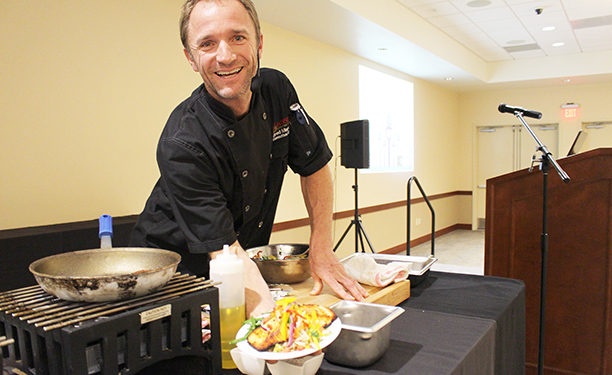 """Executive Chef Brad Martin featured on ABC's hit show """"The Taste,"""" presented a healthy cooking demonstration at the beginning of the seminar. Participants were encouraged to ask Martin questions about cooking with diabetes."""