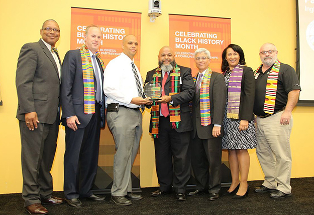 Inglewood Unified School District Chief Deputy Superintendent Joe Dominguez (fourth from left) accepts the Energy Efficiency Participation Award for energy conservation at schools in his district during Southern California Edison's recent Black History Month Celebration. SCE President Pedro Pizarro (third from right) and Lisa Cagnolatti (second from right), vice president, Business Customer Division.