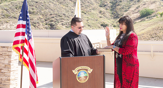 Pictured Chairwoman Lynn Valbuena being sworn into office by San Manuel Court Chief Judge Anthony Lee