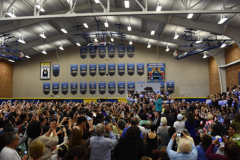 Clinton spoke to a packed house at Johnson Family Practice Center at UC Riverside. 1500 people who couldn't get insider were listening outside. Photo by Patrick Edgett.