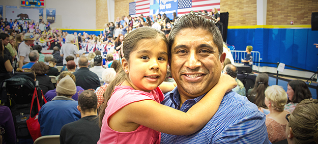Jesse Reyes of Riverside with his daughter prior to Hillary Clinton rally held at UC Riverside
