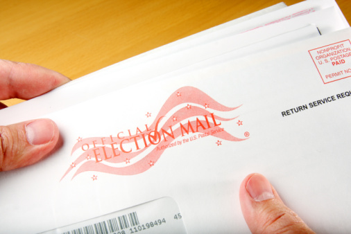 Voter receiving ballot in mail.